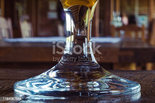 istock The reflection of the bar interior in the glass of cold lager beer 1164087554