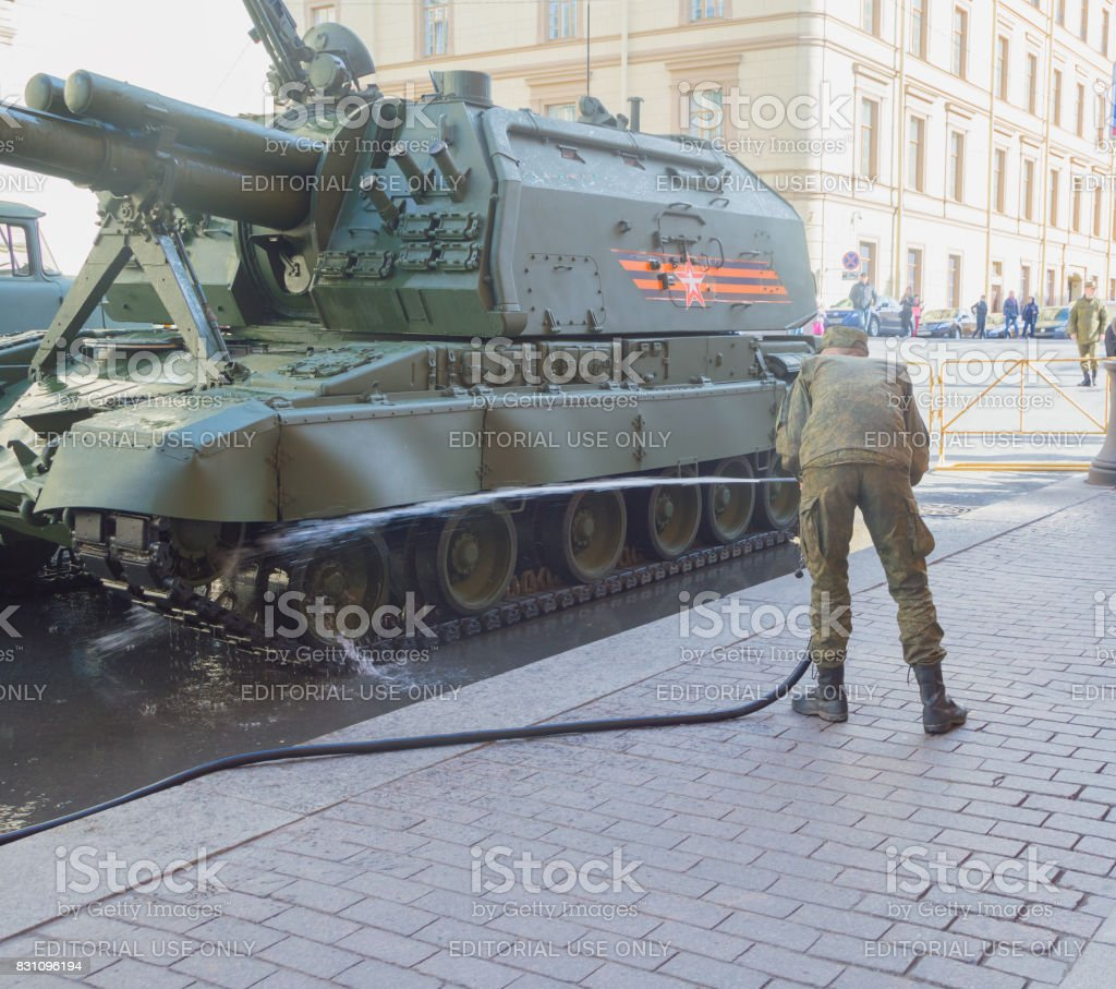 the rehearsal of the victory parade - washing armored vehicles before the show stock photo