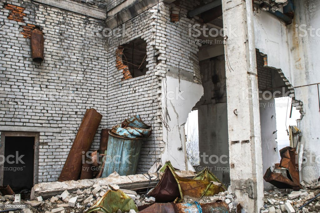 The remains of the destroyed building in the form of broken...