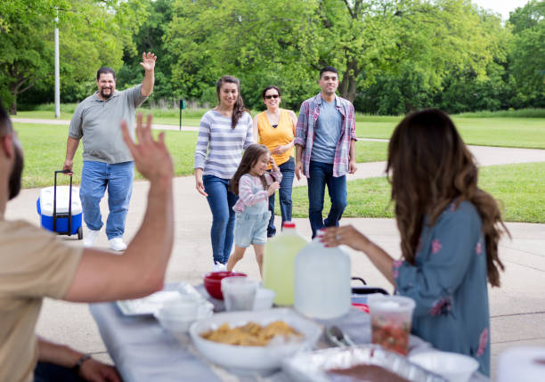 The rest of the family arrives and waves The rest of the large extended family waves as they arrive at the pavilion for the picnic. pavilion stock pictures, royalty-free photos & images