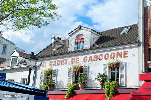 Paris, France - April 24, 2018: The restaurant Au Cadet de Gascogne on the Place du Tertre in the famous district of Montmartre on a fall day