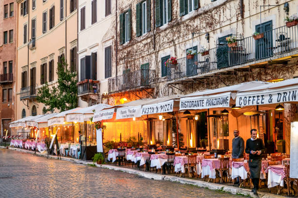 The typical Italian restaurants of Piazza Navona in Rome seem empty and without tourists stock photo