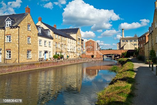 Recently built housing enhances the historic canal near Ebley Mill on the restored Stroudwater Canal, Stroud, Gloucestershire, UK.