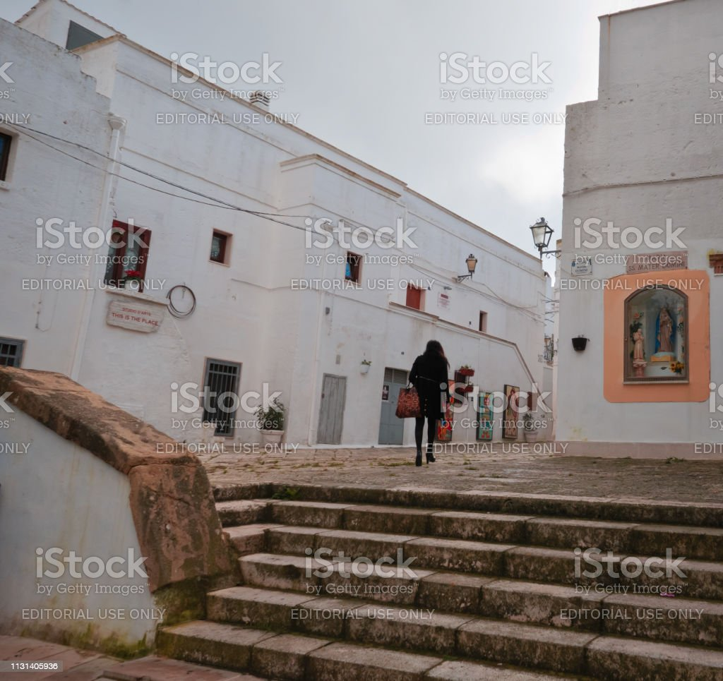 Alberobello,Italy,; rear view of a woman in the old city of...