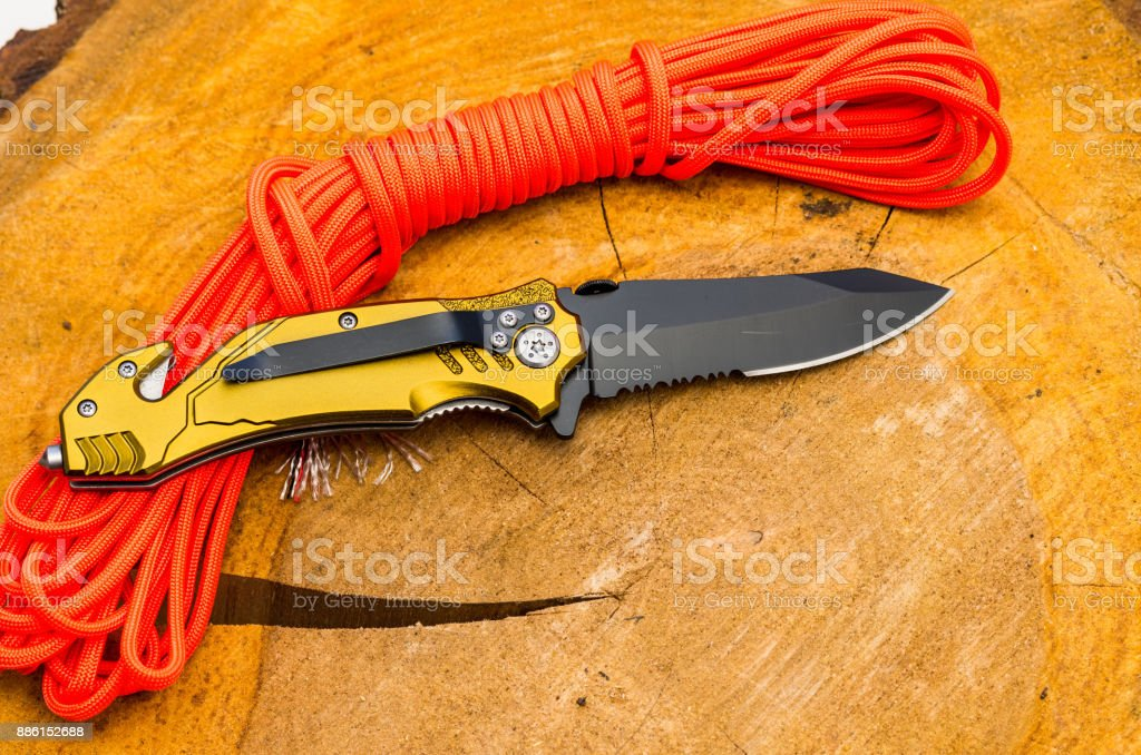 The reverse side with the clip for carrying. Knife for everyday carrying. Knife with tools for survival. stock photo