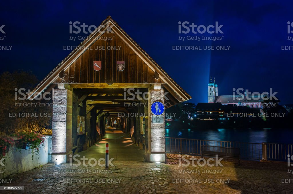 The Rhine with the wood bridge and Fridolins minster in Bad Saeckingen stock photo