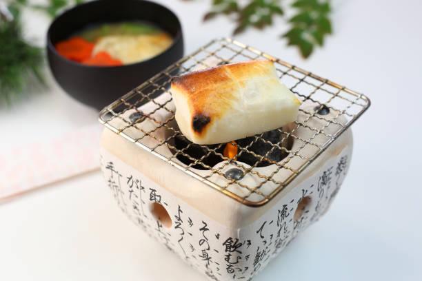 Der Reiskuchen, die ich mit einem Ton Holzkohle-Ofen gebacken – Foto