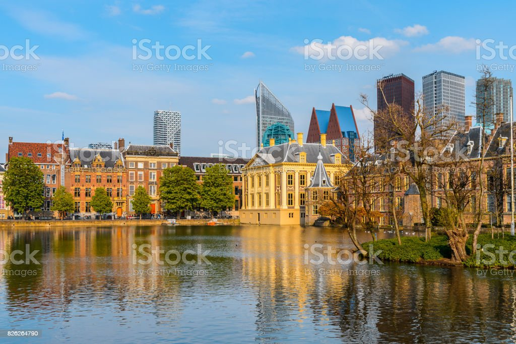 The Ridderzaal in Binnenhof with the Hofvijver lake. Meeting place of States General of the Netherlands, the Ministry of General Affairs and the office of the Prime Minister of Netherlands stock photo