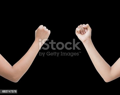 istock The right back and front side hand of the woman show Rock Paper Scissors sign for find the winners fair in the game. show rock or hammer sign. isolated on black background. 683747576