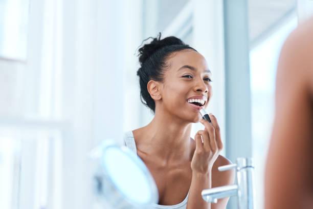 the right lipstick can do wonders - woman make up imagens e fotografias de stock