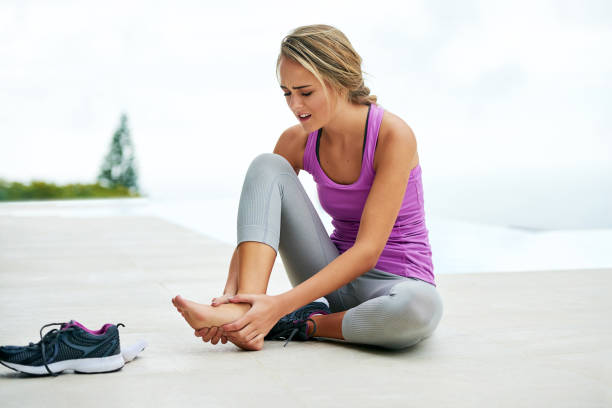 the right shoe plays a big role in your workout - pain stock photos and pictures