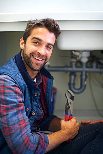 The right tool for the job Shot of a plumber fixing a pipe pipefitter stock pictures, royalty-free photos & images