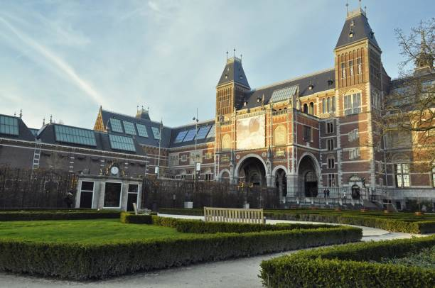 The Rijks Museum and the garden Landscape view of the west facade of the national Museum (Rijksmuseum) located in the Museum district on the Museumplein, shot from the garden rijksmuseum stock pictures, royalty-free photos & images