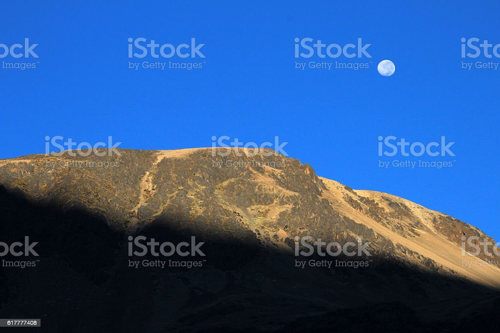 The rising sun at the Quyllurit'i inca festival in stock photo