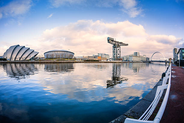 The River Clyde, Glasgow Landmarks on the River Clyde in Glasgow looking towards the Clyde Arc bridge. theasis stock pictures, royalty-free photos & images