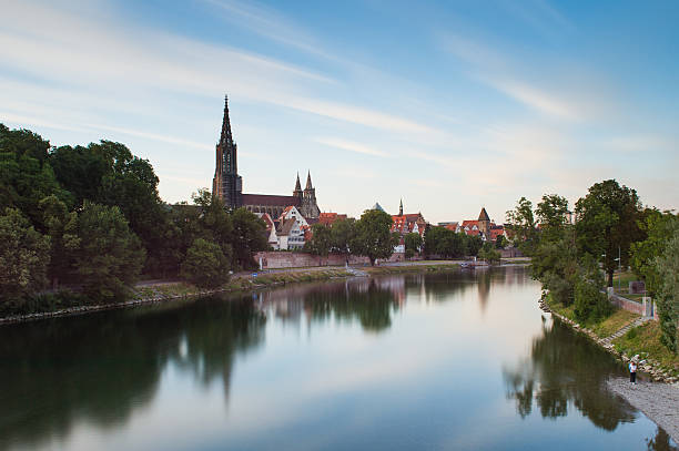 The river Danube and the Ulm skyline Long exposure of the river Danube and Ulm skyline with Ulmer Minster (cathedral) against blue sky ulm stock pictures, royalty-free photos & images
