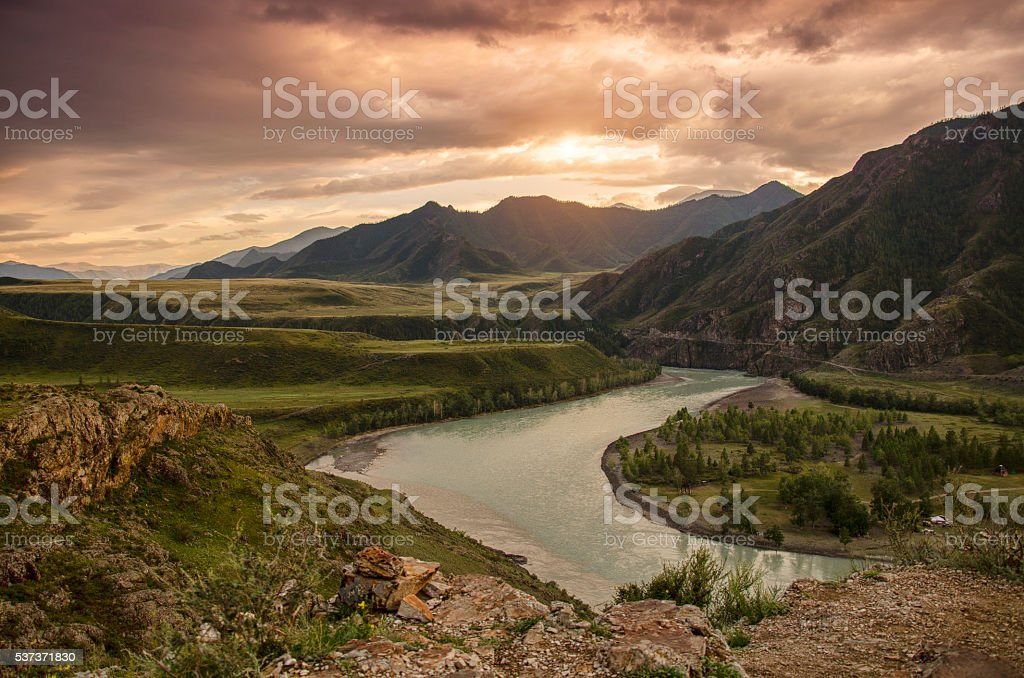 The river in the Altai mountains at sunset stock photo