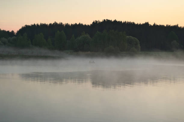 The river is covered with fog stock photo