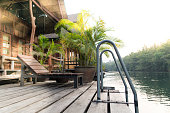 the river Kwai view at rafting cottage terrace on sunset