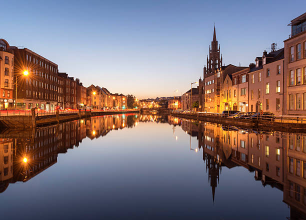 the river lee in cork city, ireland at night. - republic of ireland stock pictures, royalty-free photos & images