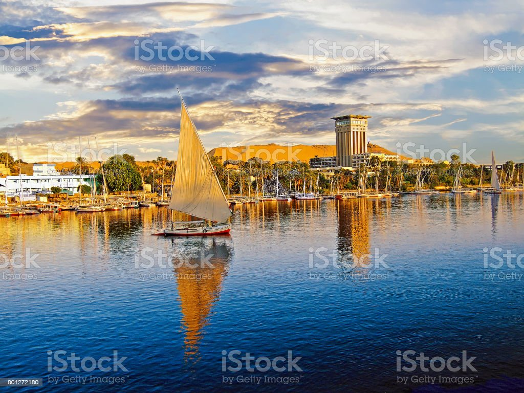 The River Nile at Luxor with boats and cloudscape stock photo