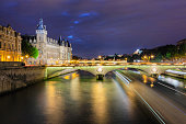 Evening descends upon the River Seine in Paris, France. In the middle distance we see the elegant Pont au Change.