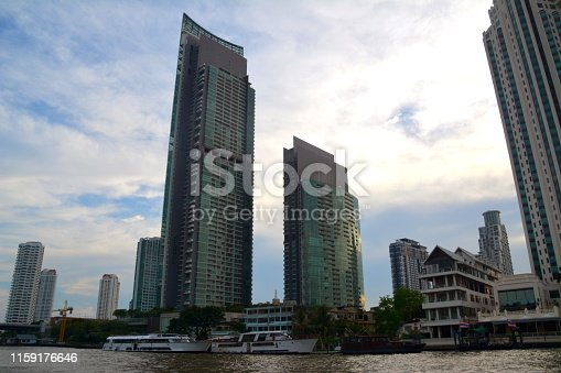The River skyscrapers at sunset, overlooking the Chao Praya River in Bangkok, Thailand.
