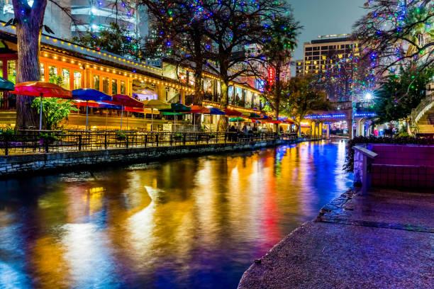 The Riverwalk at San Antonio, Texas, at Night. Night Time Scenic Views of the Riverwalk with Christmas Lights on a Rainy Day at San Antonio, Texas. san antonio texas stock pictures, royalty-free photos & images