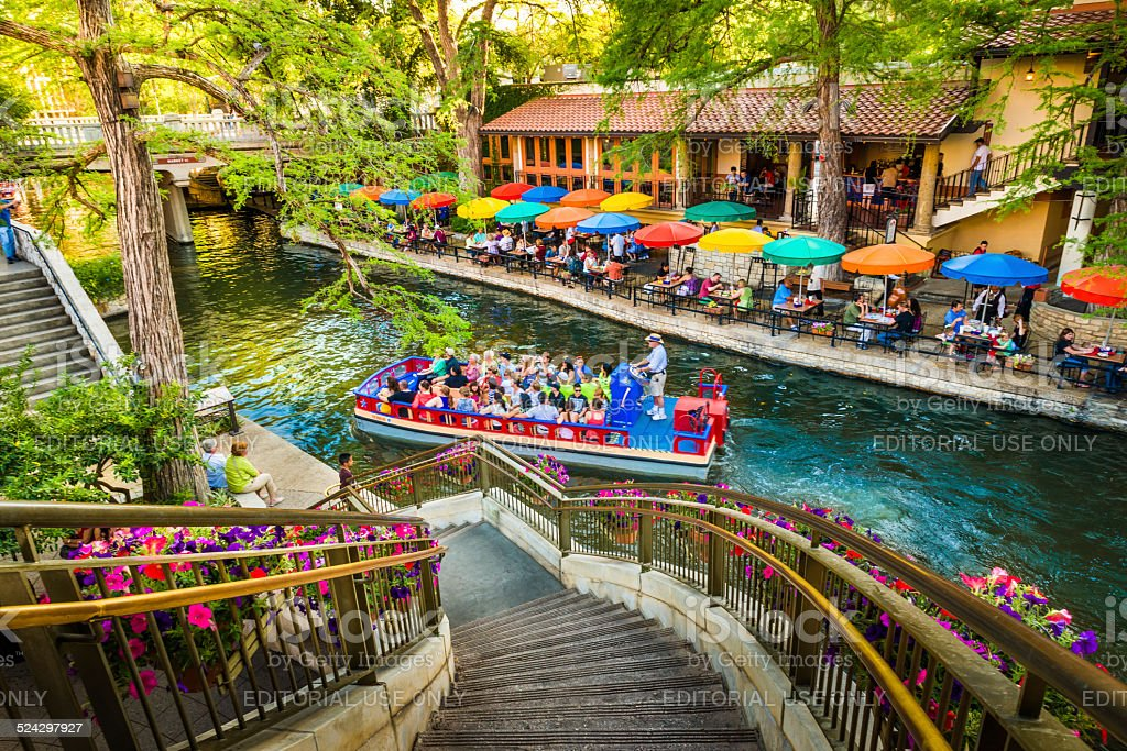 The riverwalk, San Antonio park walkway scenic canal tour boat stock photo