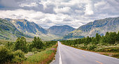 istock The Road Ahead through the Majestic Mountain-range of Norway 1083241218