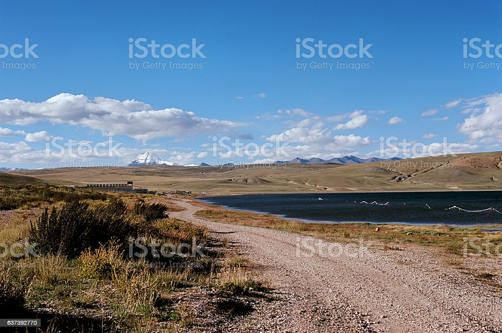 The road along the shore of sacred Lake Manasarovar. stock photo