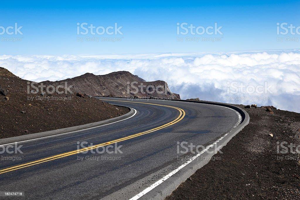 "the road at haleakala volcano, maui, hawaii, USA. ""a winding road seems to lead to the sky. road to haleakala volcano, maui, hawaii, USA."" Asphalt Stock Photo"