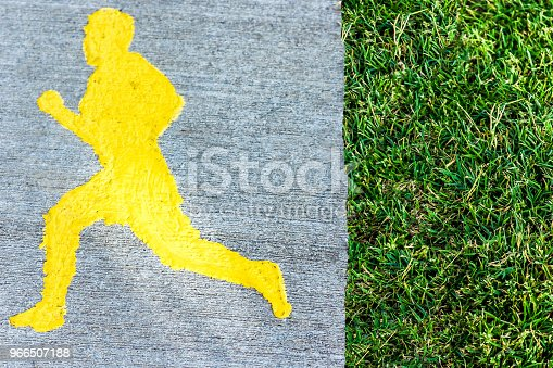 istock The road for sports with the image of a running man, near the grass 966507188