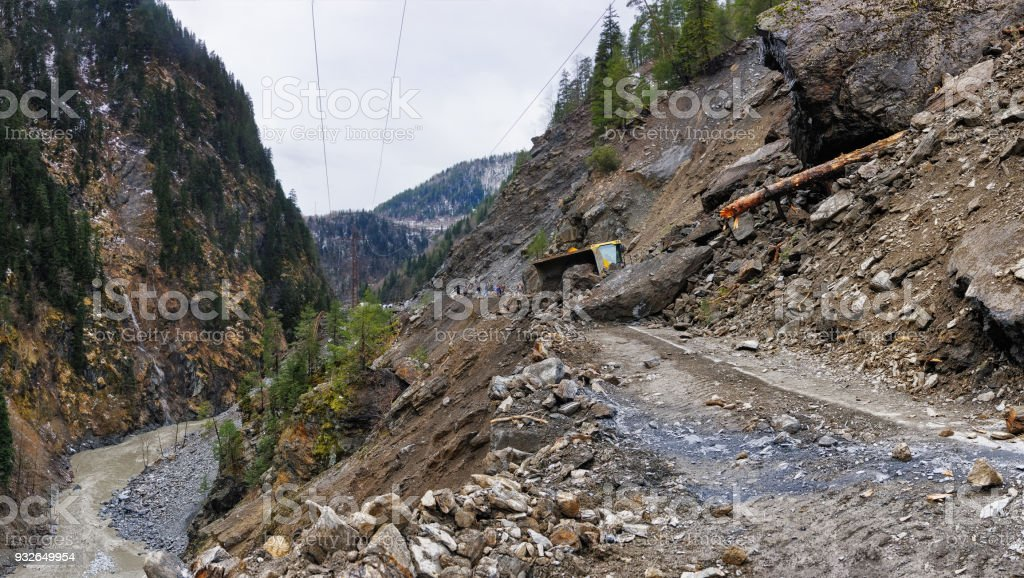 The road from Mestia to Zugdidi was blocked by a rockfall. Local Georgian road services are clearing the road. Samegrelo Zemo-Svaneti, Georgia 9.03.2018 stock photo