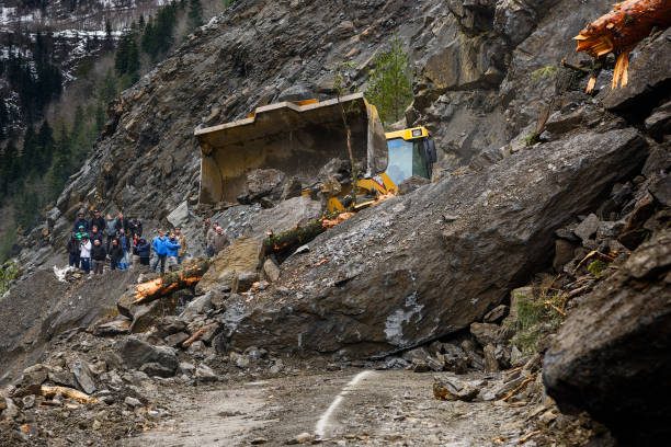 The road from Mestia to Zugdidi was blocked by a rockfall. The road from Mestia to Zugdidi was blocked by a rockfall. Local Georgian road services are clearing the road. People are watching the progress of road works. Samegrelo Zemo-Svaneti, Georgia 9.03.2018 landslide stock pictures, royalty-free photos & images