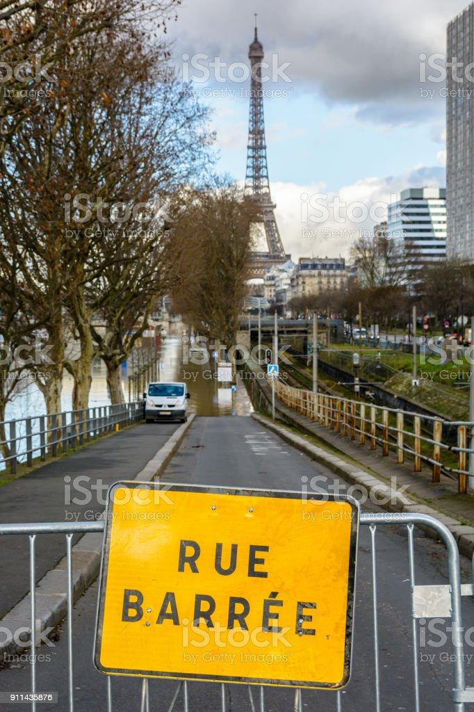 The road going down to the Grenelle port, along the RER C railway, is closed by a safety barrier after the Seine flooded the wharfs during a winter flooding episode stock photo