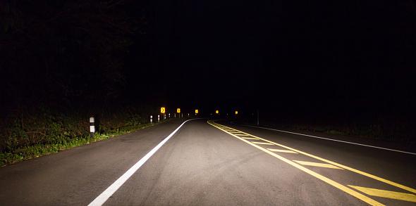 istock The road on dark night. 701244376