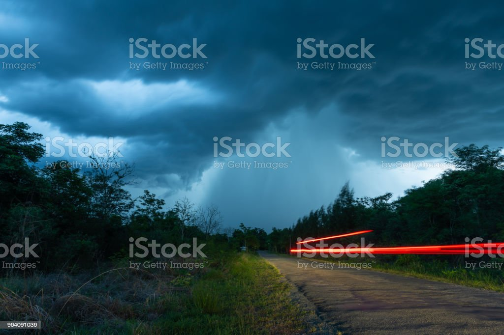 The road that leads to the falling rain from the thick Nimbus cloud - Royalty-free Abstract Stock Photo