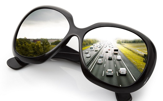 view of the road through glasses