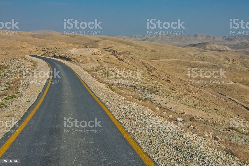 The road to Holy Lavra of Saint Sabbas in Israeli desert stock photo