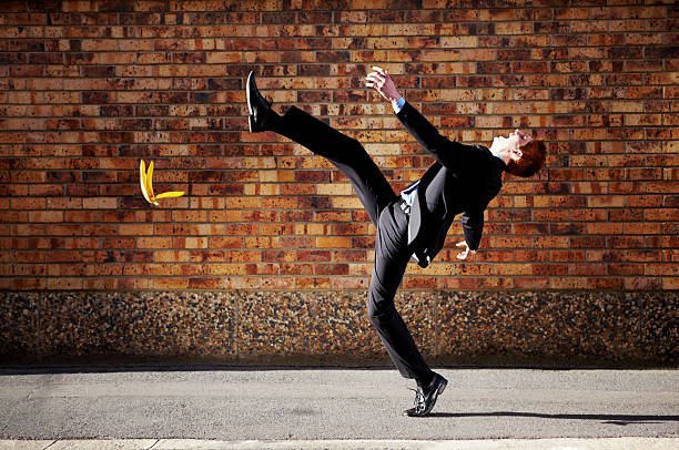 The road to success is a slippery one at best A young businessman slipping on a banana peelhttp://195.154.178.81/DATA/i_collage/pi/shoots/781055.jpg banana peel stock pictures, royalty-free photos & images