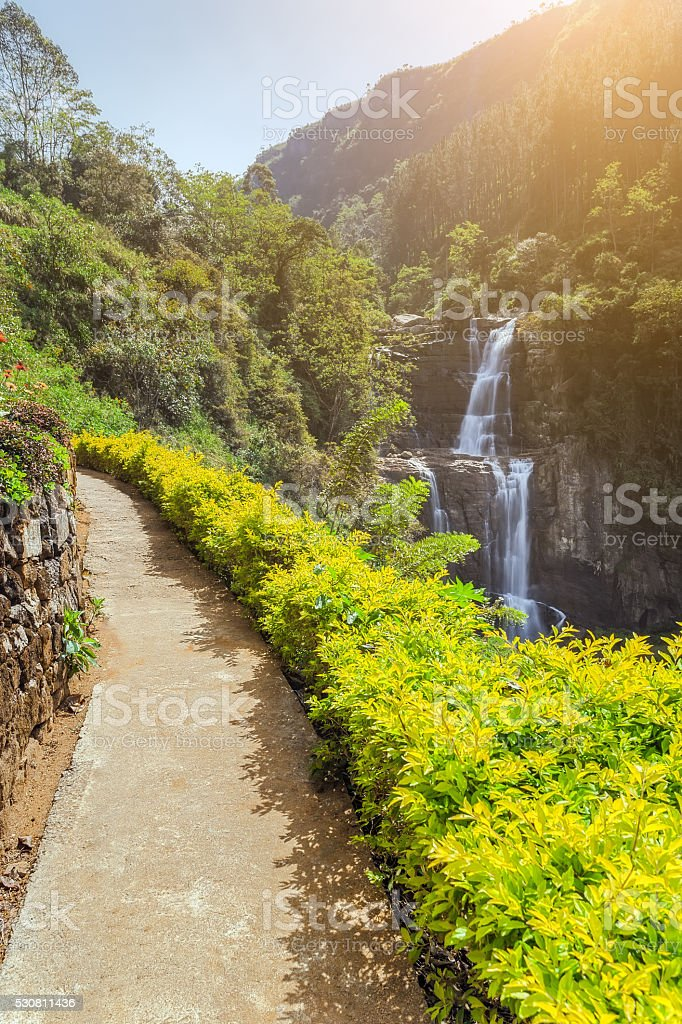 The road to the beautiful waterfalls Ramboda in sunny weather, stock photo