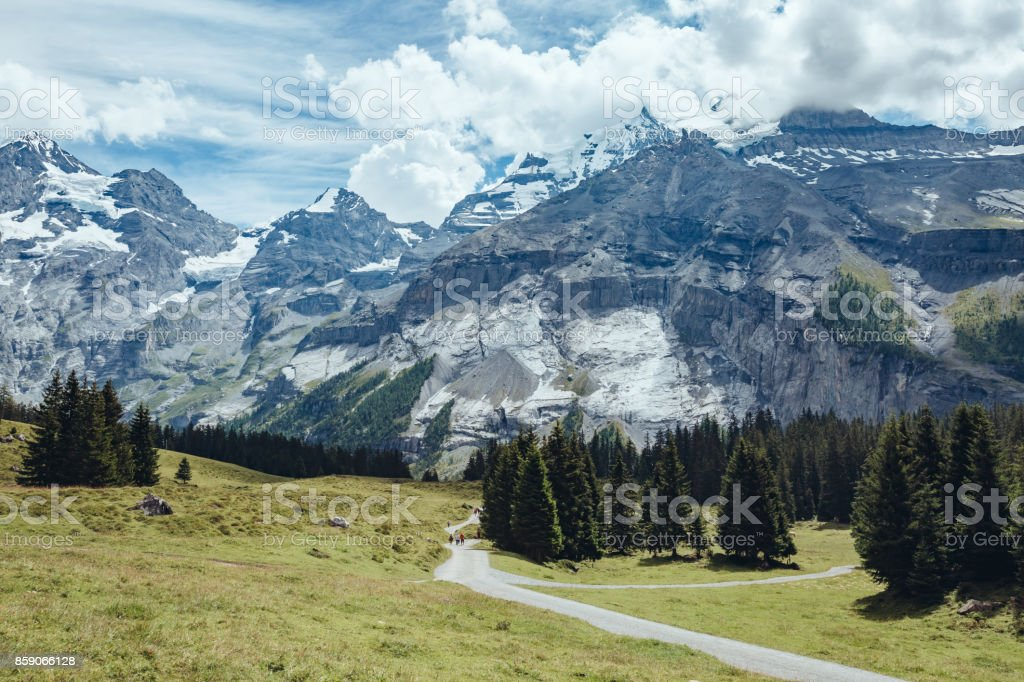 The road to the picturesque glacial lakes Oeschinensee. Location Swiss alps, Kandersteg, Bernese Oberland, Europe. stock photo