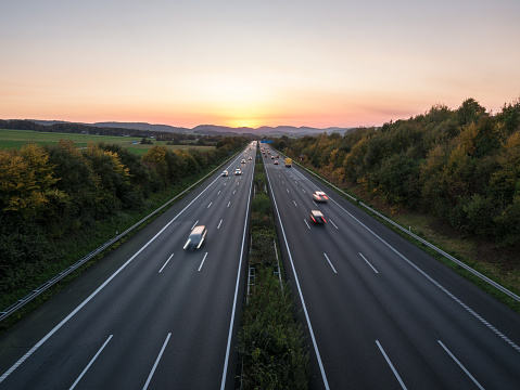 The road traffic on a motorway at sunset