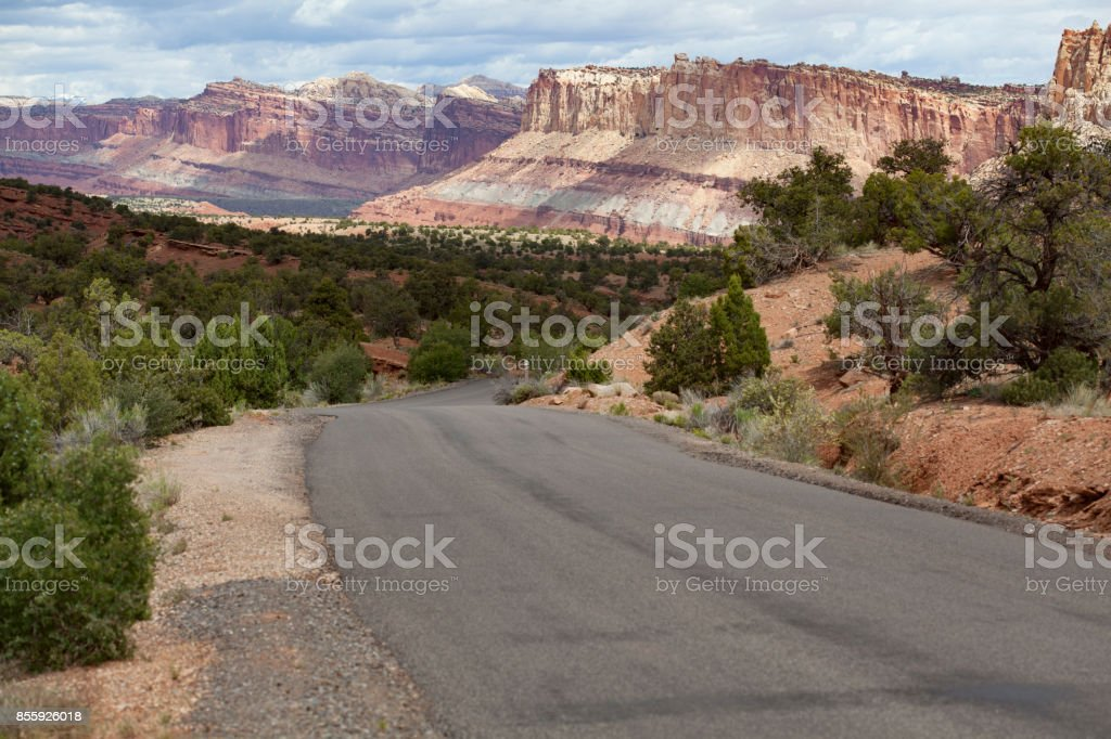 The roads through Capitol Reef National Park make it easy for visitors to witness the beautiful rock strata of this unique landscape stock photo