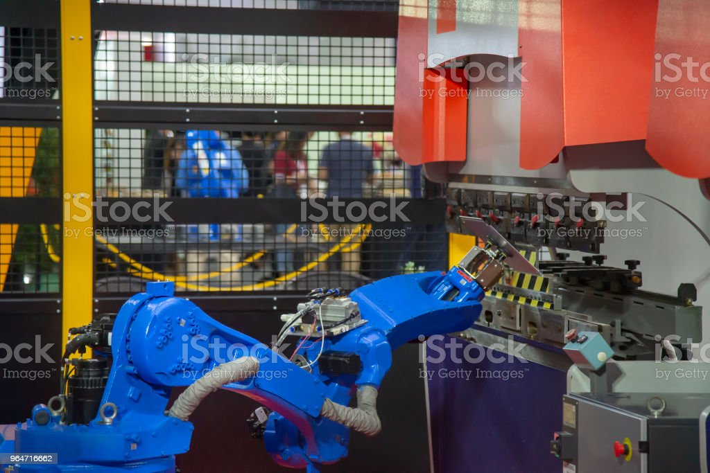 The robot arm for handing sheet metal in bending process with the hydraulic bending machine. royalty-free stock photo