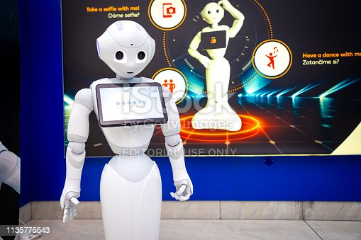istock The Robot consultant with digital tablet in Prague airport. The robot is making multi-lingual announcement 1135775543