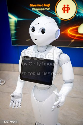 istock The Robot consultant with digital tablet in Prague airport. The robot is making multi-lingual announcement 1135775544