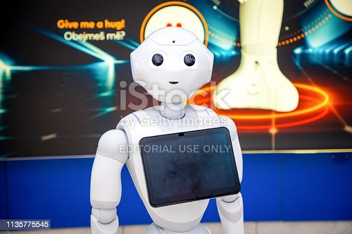 istock The Robot consultant with digital tablet in Prague airport. The robot is making multi-lingual announcement 1135775545