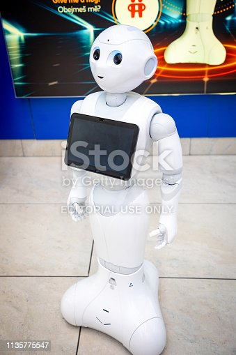 istock The Robot consultant with digital tablet in Prague airport. The robot is making multi-lingual announcement 1135775547